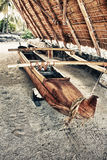 Primitive wooden boat. In a shelter in Hawaii, place of refuge Stock Images