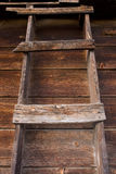 Primitive wooden ladder in old barn Stock Photography