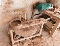 Primitive wooden pottery and red clay stock photography