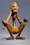 Primitive wooden statue of Lombok Royalty Free Stock Image