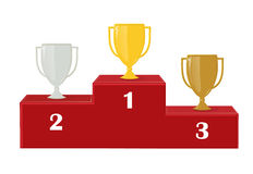 In primo luogo, secondo e terzo posto Premio per la vittoria: oro, argento e rame Vincitori della tazza sul piedistallo rosso Fotografie Stock