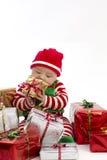Primo natale di Babys che mangia presente Fotografia Stock