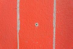Primo piano arancio arrugginito di struttura della parete del cemento di colore Fotografie Stock