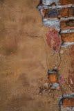 Primo piano arancio del muro di mattoni Fotografia Stock