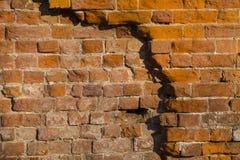 Primo piano arancio del muro di mattoni Fondo di pietra Immagini Stock Libere da Diritti