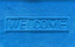 Primo piano benvenuto dello zerbino del blu Fotografie Stock