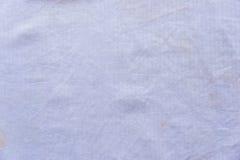 Primo piano bianco sporco di struttura del tessuto Immagini Stock