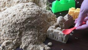 Primo piano cinetico della sabbia stock footage
