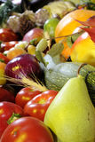 Primo piano con la pera ed i pomodori Fotografia Stock
