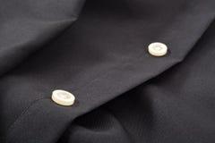 Primo piano dei bottoni di camicia Immagine Stock