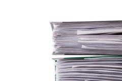Primo piano dei documenti di affari su un fondo bianco fotografie stock