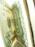 Primo piano dei dollari dei soldi di carta Immagini Stock
