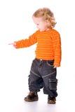 Primo piano del bambino grazioso che indica a qualcosa, Fotografie Stock