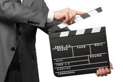 Primo piano del bordo di valvola di film della tenuta dell'uomo su bianco Immagine Stock