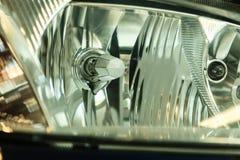 Primo piano del dettaglio del faro dell'automobile Fotografie Stock