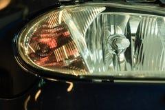 Primo piano del dettaglio del faro dell'automobile Fotografia Stock