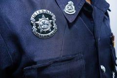 Primo piano del distintivo dell'ufficiale di polizia della Malesia Immagine Stock Libera da Diritti
