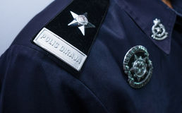 Primo piano del distintivo dell'ufficiale di polizia della Malesia Fotografie Stock Libere da Diritti