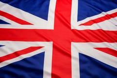 Primo piano del fondo BRITANNICO della bandiera di Union Jack della bandiera di Britannici immagini stock
