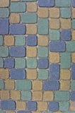 Primo piano del fondo di struttura del ciottolo, verde variopinto verticale, giallo, blu, abbronzatura, grey, gray, concio beige Fotografia Stock Libera da Diritti