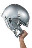 Primo piano del giocatore di football americano che passa il suo casco del nastro Fotografie Stock Libere da Diritti