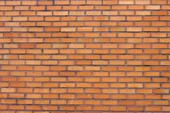 Primo piano del muro di mattoni di Brown, struttura, superficie irregolare, fondo fotografie stock libere da diritti
