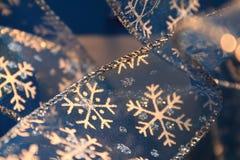 Primo piano del nastro del fiocco di neve Fotografie Stock