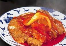 Primo piano del piatto cinese: pollo/pesci del limone Fotografia Stock