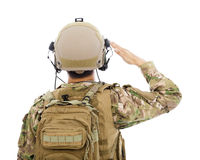 Primo piano del soldato nel saluto dell'uniforme militare Fotografie Stock Libere da Diritti