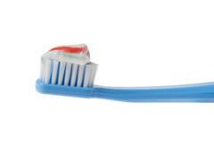 Primo piano del Toothbrush e del dentifricio in pasta Immagini Stock Libere da Diritti