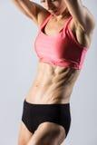 Primo piano del torso di bella donna atletica Fotografie Stock