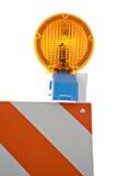 Primo piano dell'indicatore luminoso d'avvertimento e della barriera Fotografie Stock Libere da Diritti
