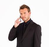 Primo piano dell'uomo d'affari con il telefono delle cellule Fotografie Stock