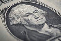 Primo piano della banconota in dollari del ritratto uno Immagini Stock