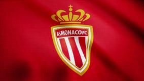 Primo piano della bandiera d'ondeggiamento con FC COME logo del club di calcio del Monaco, ciclo senza cuciture Animazione editor stock footage