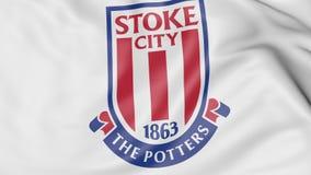 Primo piano della bandiera d'ondeggiamento con il logo del club di calcio di Stoke City, rappresentazione 3D Immagini Stock