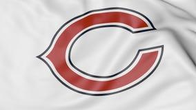 Primo piano della bandiera d'ondeggiamento con il logo del gruppo di football americano del NFL di Chicago Bears, rappresentazion Fotografie Stock Libere da Diritti