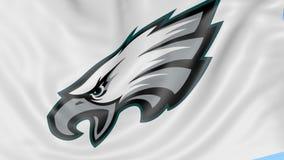 Primo piano della bandiera d'ondeggiamento con il logo del gruppo di football americano del NFL di Philadelphia Eagles, ciclo sen royalty illustrazione gratis