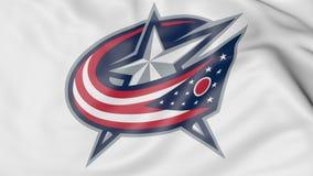 Primo piano della bandiera d'ondeggiamento con il logo della squadra di hockey del NHL di Columbus Blue Jackets, rappresentazione Immagini Stock