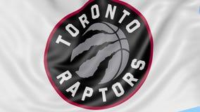 Primo piano della bandiera d'ondeggiamento con il logo della squadra di pallacanestro di NBA dei rapaci di Toronto, ciclo senza c illustrazione di stock