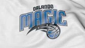 Primo piano della bandiera d'ondeggiamento con il logo della squadra di pallacanestro di NBA di Orlando Magic, rappresentazione 3 Fotografia Stock