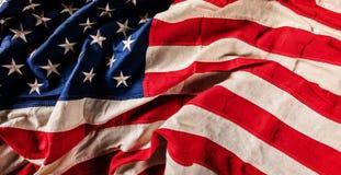 Primo piano della bandiera di U.S.A. nella progettazione di lerciume Immagine Stock