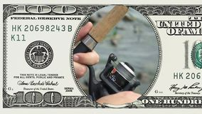 Primo piano della bobina di pesca nel telaio della banconota in dollari 100 video d archivio