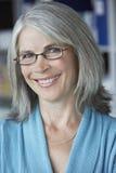 Primo piano della donna di affari Medio Evo Smiling  fotografia stock
