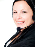 Primo piano della donna sorridente del brunette che comunica dal headp Fotografie Stock