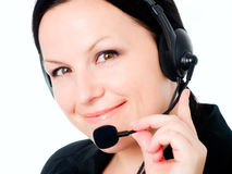 Primo piano della donna sorridente del brunette che comunica dal headp Immagine Stock Libera da Diritti