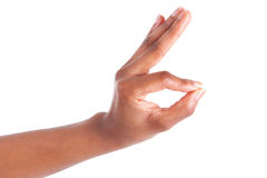Primo piano della mano della donna che gesturing - mostrare segno giusto Fotografia Stock