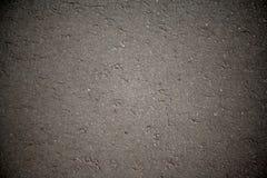 Primo piano della priorità bassa di struttura dell'asfalto. Immagini Stock