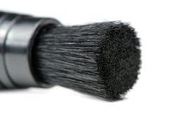 Primo piano della spazzola di pulizia della lente Immagini Stock