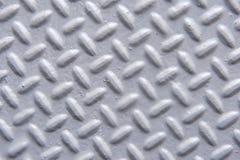 Primo piano della superficie di metallo dipinta con il modello della spina di pesce fotografia stock libera da diritti